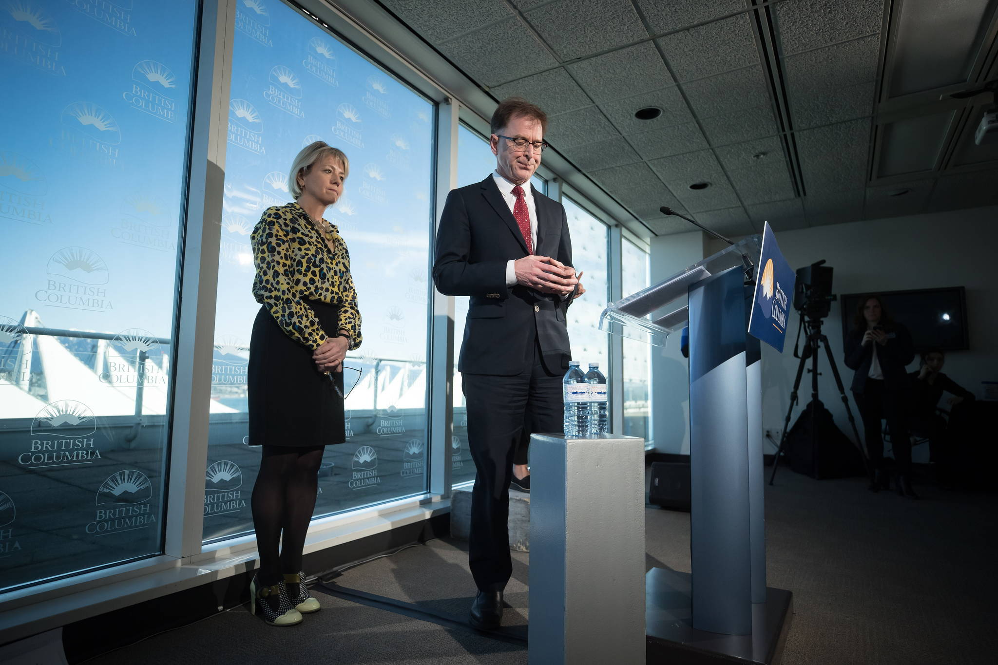 British Columbia provincial health officer Dr. Bonnie Henry, left, and B.C. Health Minister Adrian Dix pause during a news conference regarding the novel coronavirus COVID-19, in Vancouver, on Saturday, March 14, 2020. (THE CANADIAN PRESS/Darryl Dyck)